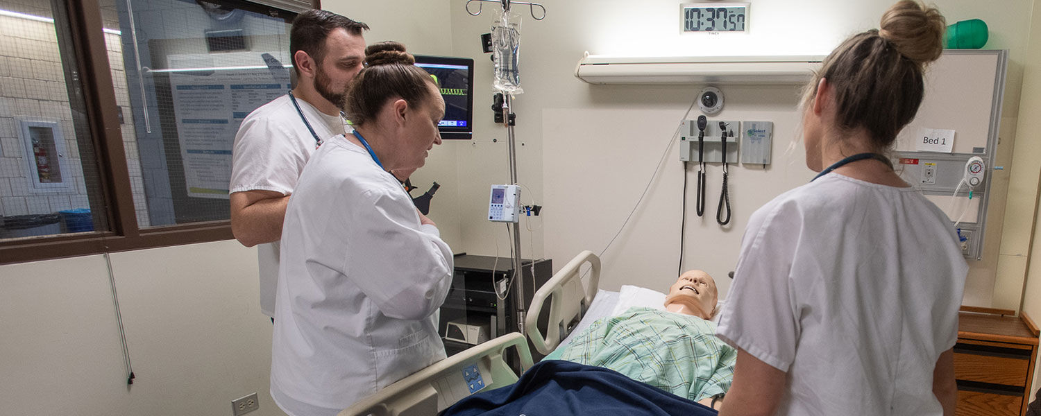 Junior nursing students participate in a simulation at Henderson Hall.