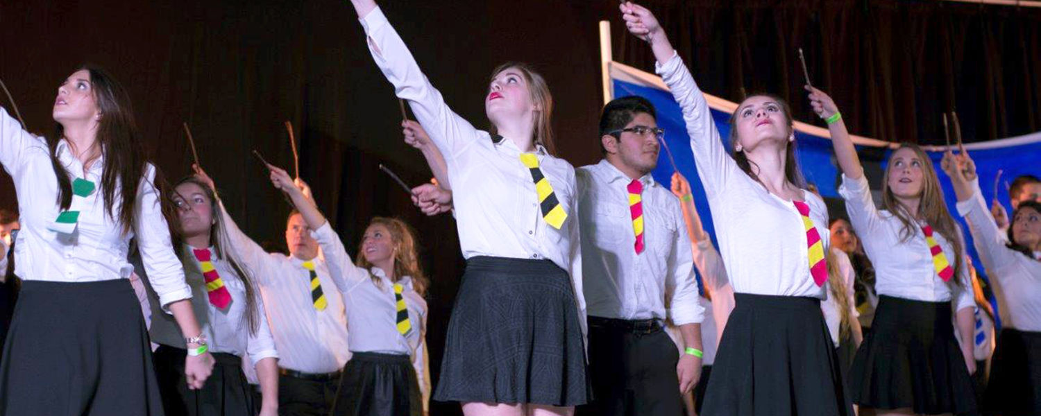 """Delta Gamma, Phi Kappa Psi, Sigma Alpha Epsilon and Sigma Chi, performing their """"Harry Potter"""" skit, end the night winning first in performance and fundraising, as well as overall Songfest winner. (Photos courtesy of Signum Design)"""