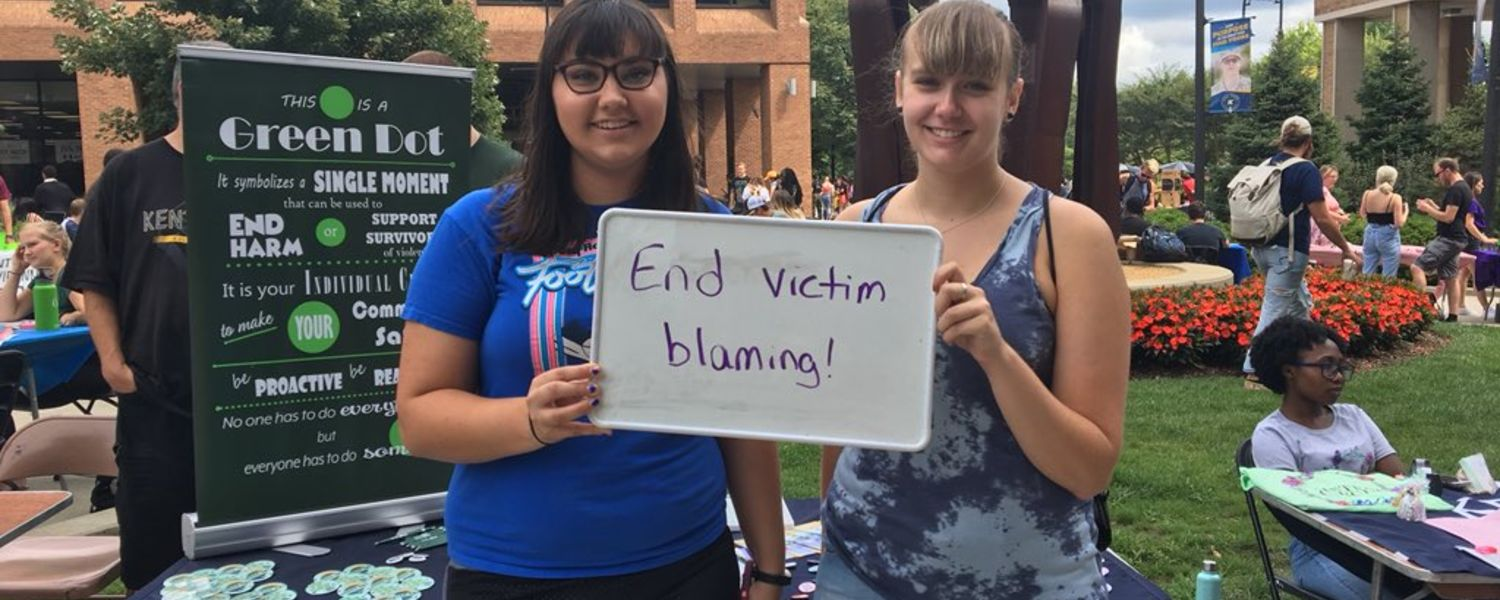 students hold up sign