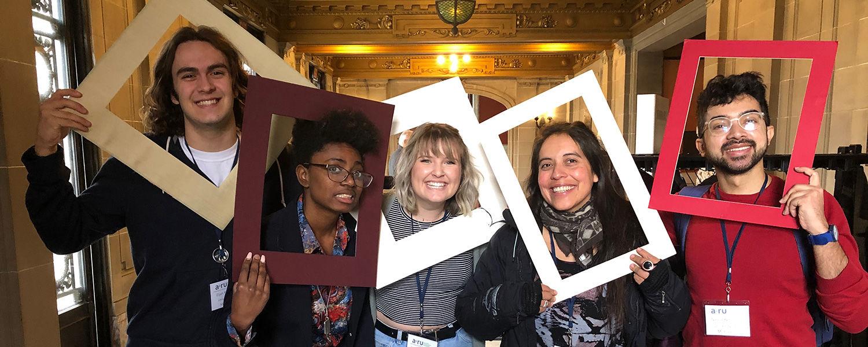 Students Holding Frames