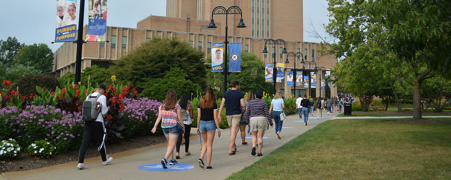 Students walking by Kent State Library