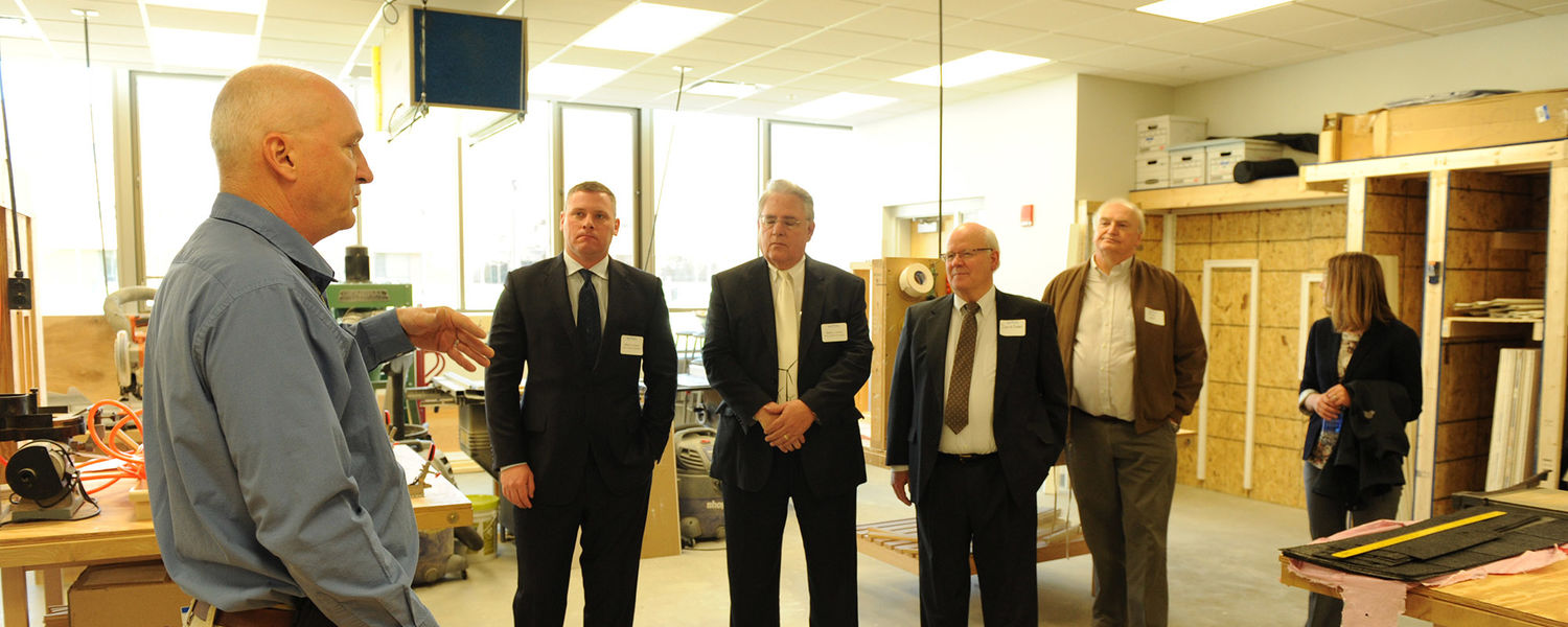 Donors  tour the construction management area in the Aeronautics and Technology building.