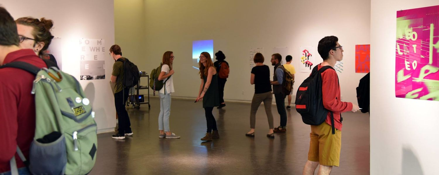 """Guests view posters on display at """"Type as/and Image"""" exhibition."""