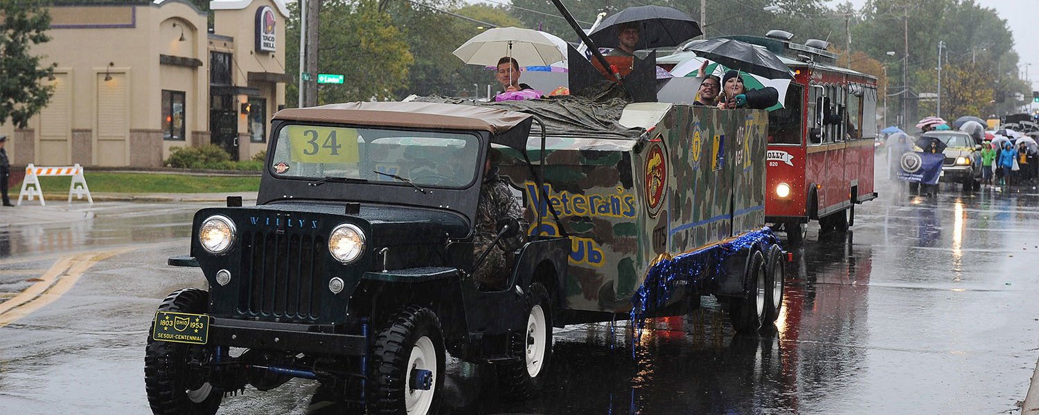 Members of Kent State's Veterans Club, a student organization, participate in the 2015 Homecoming Parade.