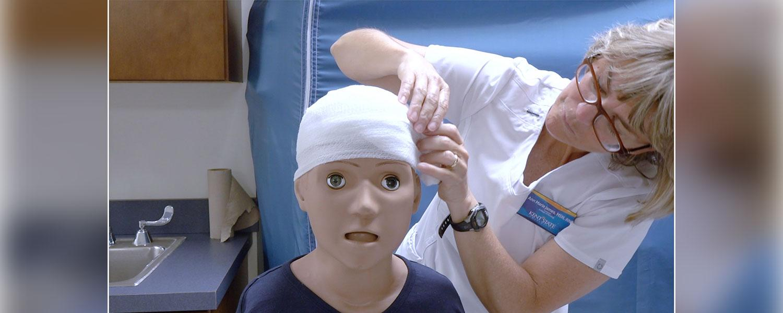 College of nursing lecturer Ann Marie James, MSN, RN, demonstrates a recurrent wrap.