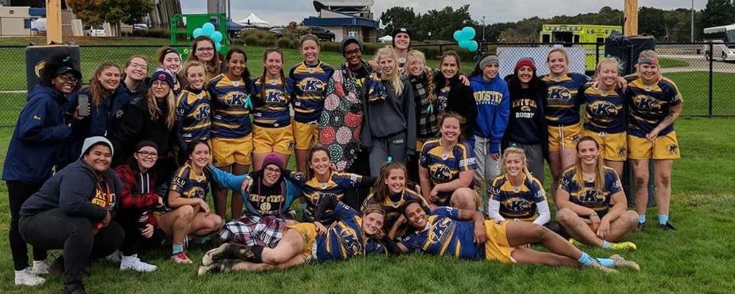 The Kent State University women's rugby team took matters into their own hands when they encountered a tree blocking the road on their way to a match. (Photo credit: Tina Miller)