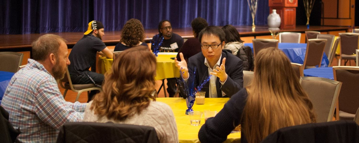 Faculty, prospective students, and their parents talk at Explore Kent Chemistry Day