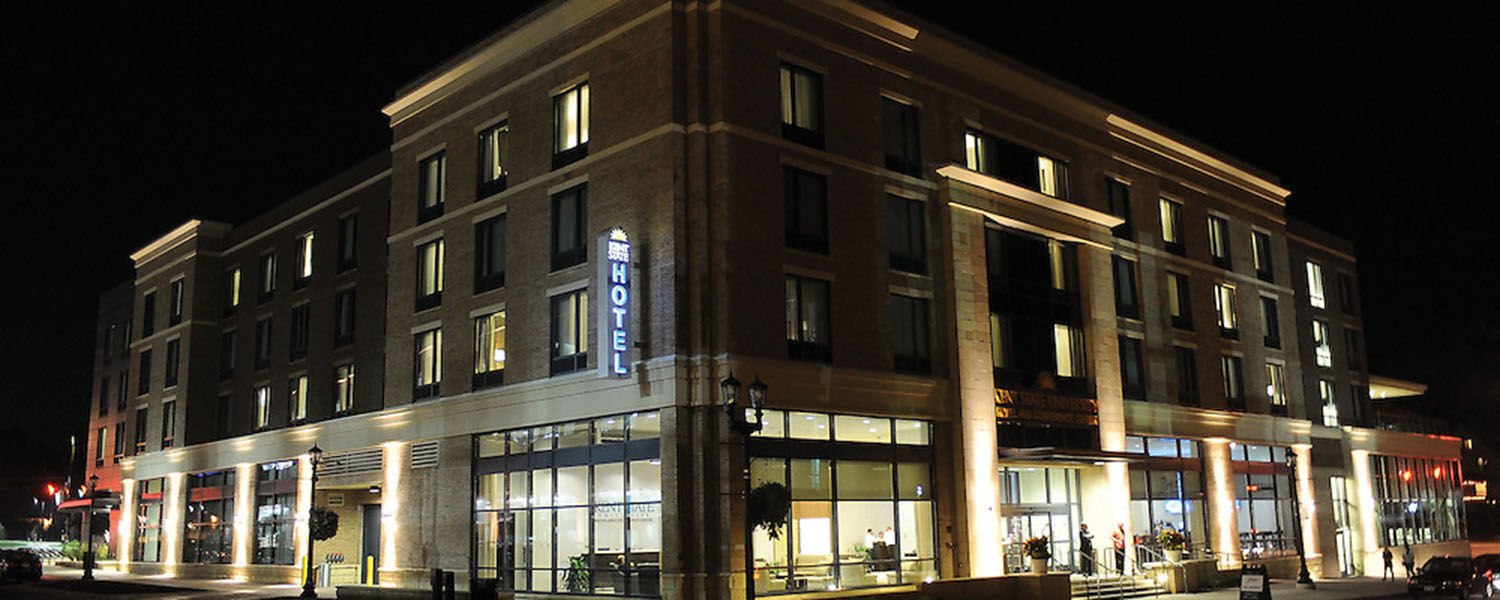 The Kent State University Hotel and Conference Center is lit up at night, welcoming visitors to downtown Kent. The hotel marked its fifth anniversary this past June.