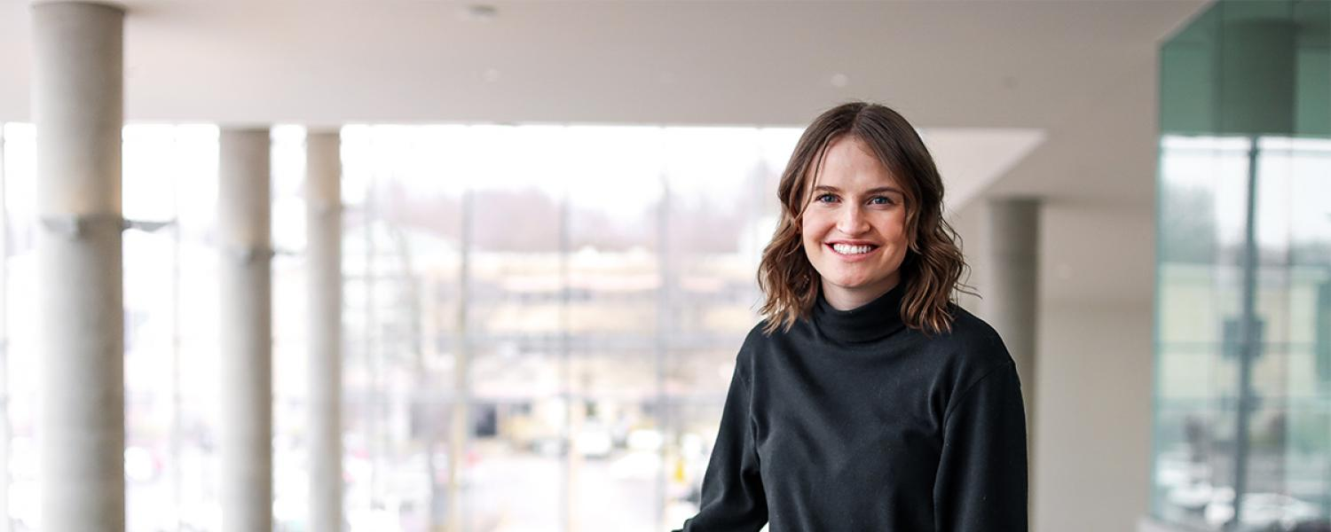Elizabeth Koenig standing in the studio of the College of Architecture and Environmental Design building.