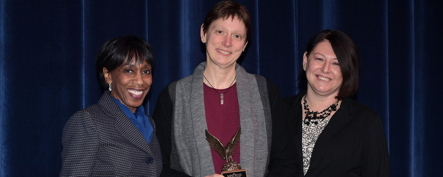 Vice President Alfreda Brown (left) and Dana Lawless-Andric (right) present the 2018 Diversity Trailblazer Award to Kathy Wilson, Ph.D., professor of economics.