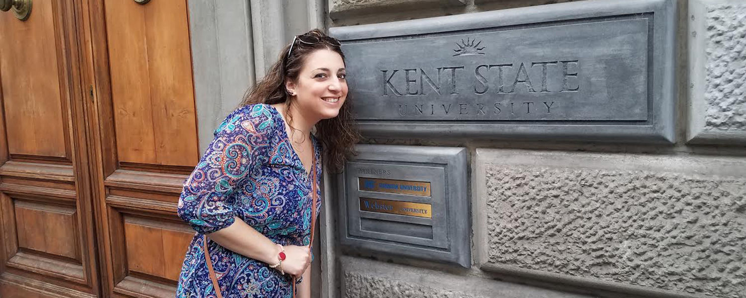 Alana Thompson, financial aid counselor, poses in front of the Kent State Florence sign during her vacation to Italy this summer.