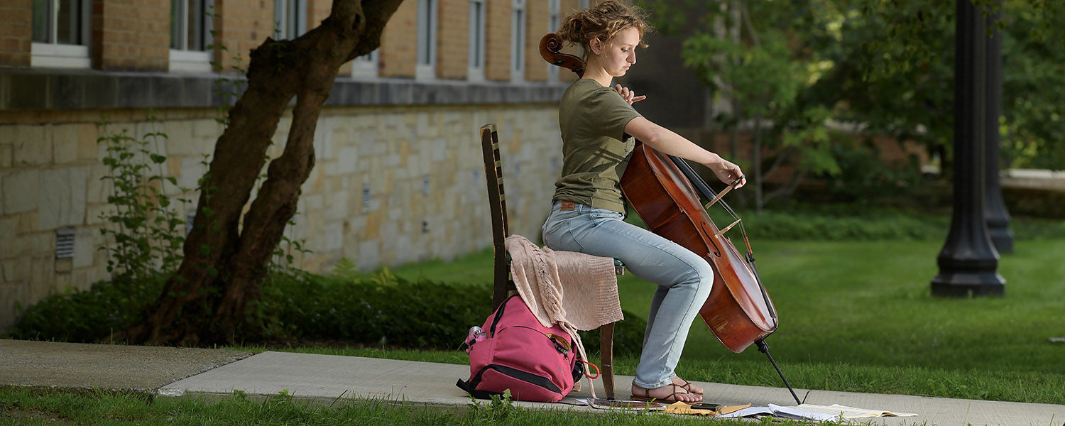 """A student from Kent State University's Hugh A. Glauser School of Music practices in what she calls """"a perfect spot"""" on campus. The poor acoustics there help her to better hear – and correct – any flaws in her performance."""