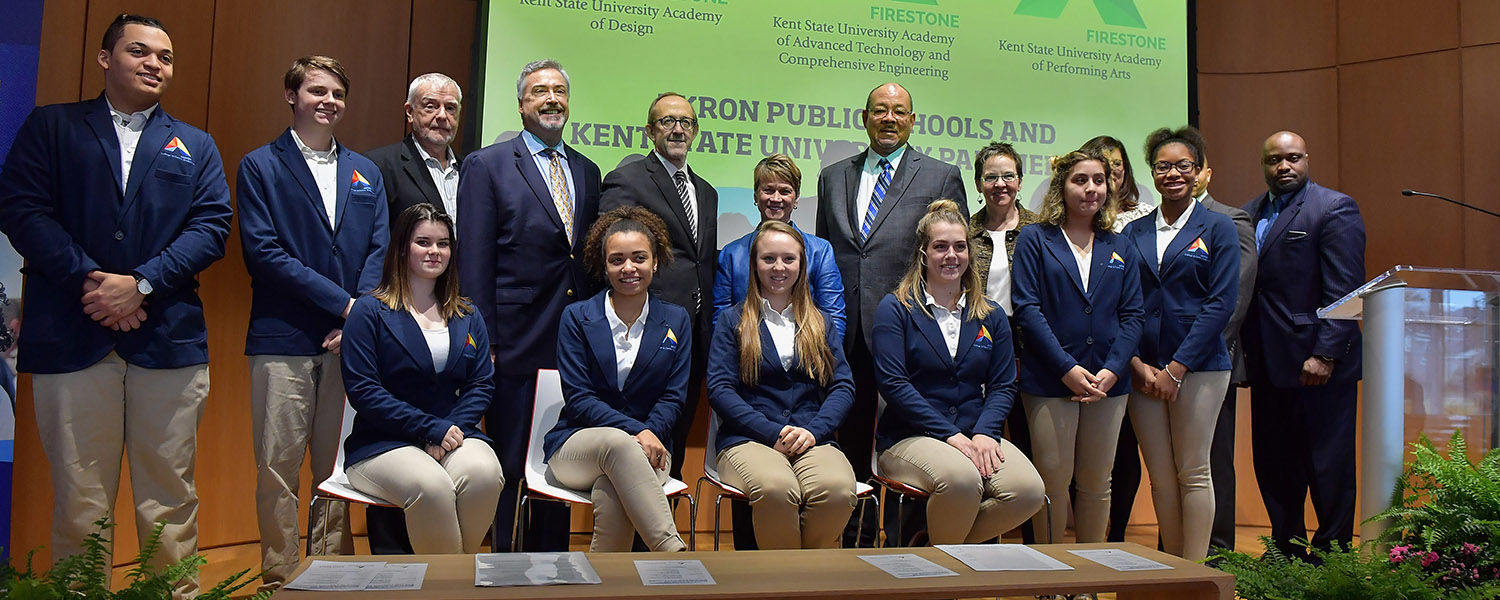 Student Ambassadors from Firestone Community Learning Center pose with Kent State deans, Kent State President Beverly J. Warren, Akron Public Schools Superintendent David James and Akron Public Schools administrators.