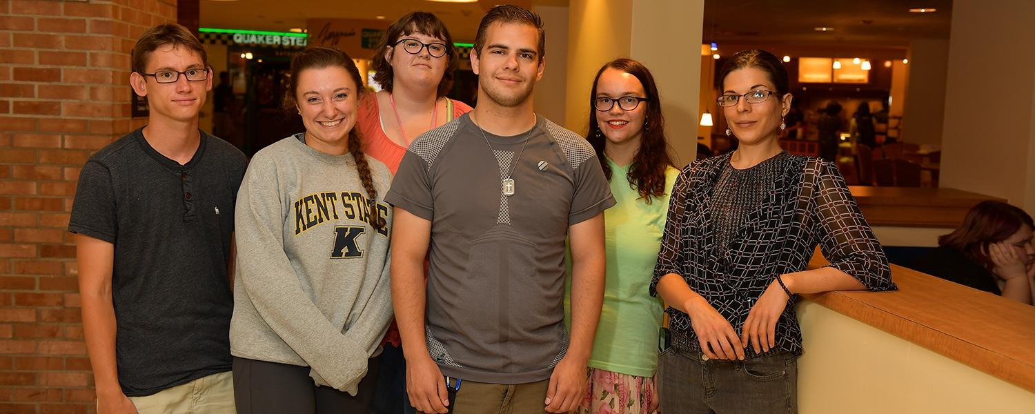 Members of Autism Connections Kent, a student organization created by students with autism spectrum disorder (ASD) and their allies, pose for a photo at the Kent Student Center during their first meeting last fall.
