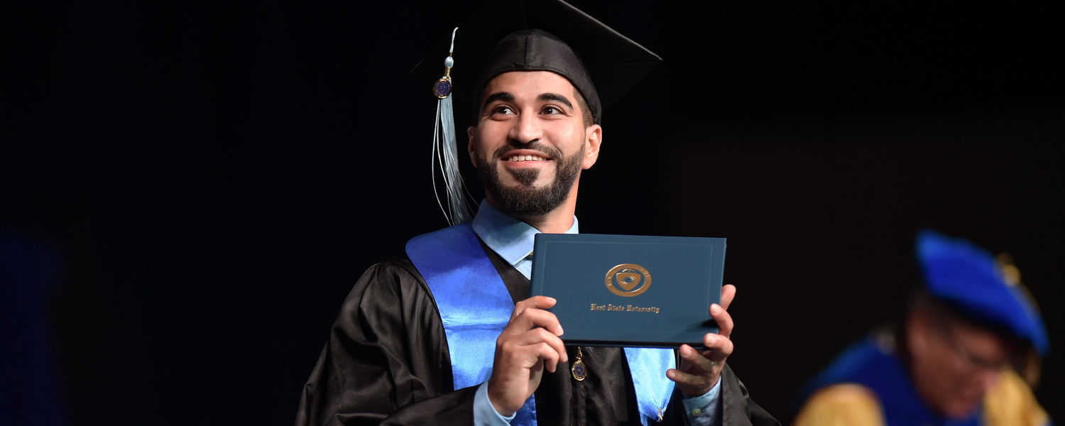A Kent State University graduate displays his diploma for family and friends during his Summer 2017 Commencement ceremony at the Memorial Athletic and Convocation Center.
