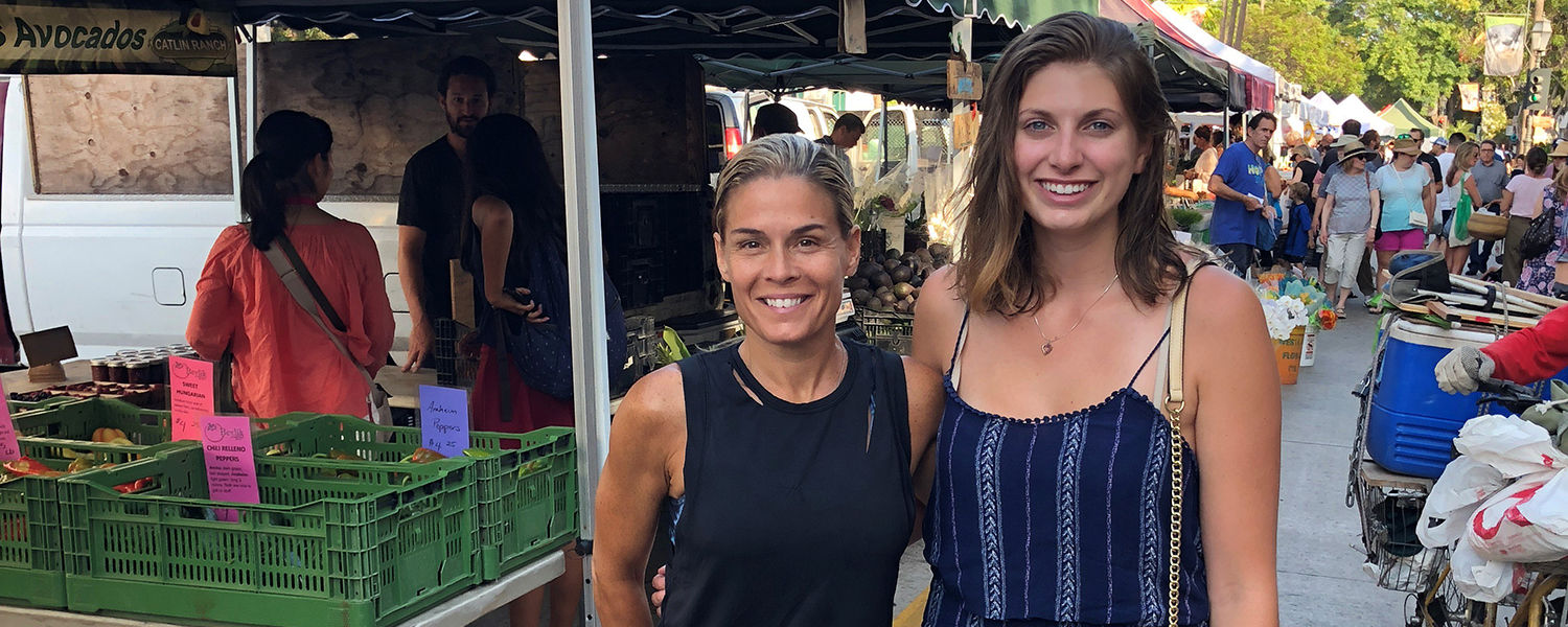 Kent State University hospitality management senior Ashley Foster (right) spent a week working with Food Network celebrity chef Cat Cora (left). (Photo provided by Ashley Foster)