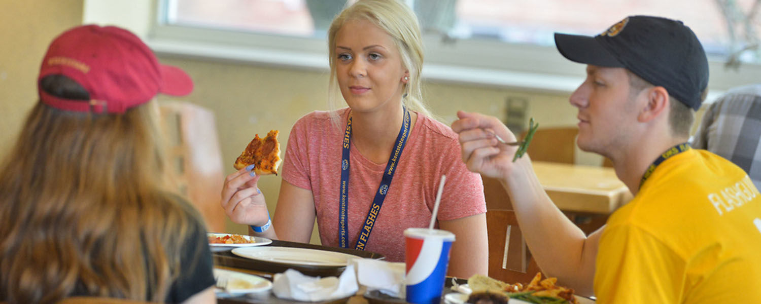 Kent State students discuss over lunch at a campus dining location. A new study by Kent State researchers aims to help combat overeating habits using optical illusions on a specially designed plate.
