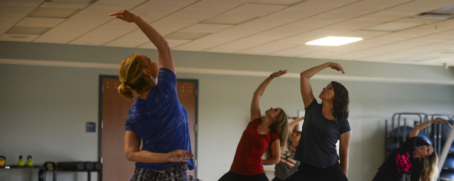 Kent State University employees participate in the Lunchtime Rejuvenation Yoga session – a regular wellness offering on Tuesdays and Thursdays.