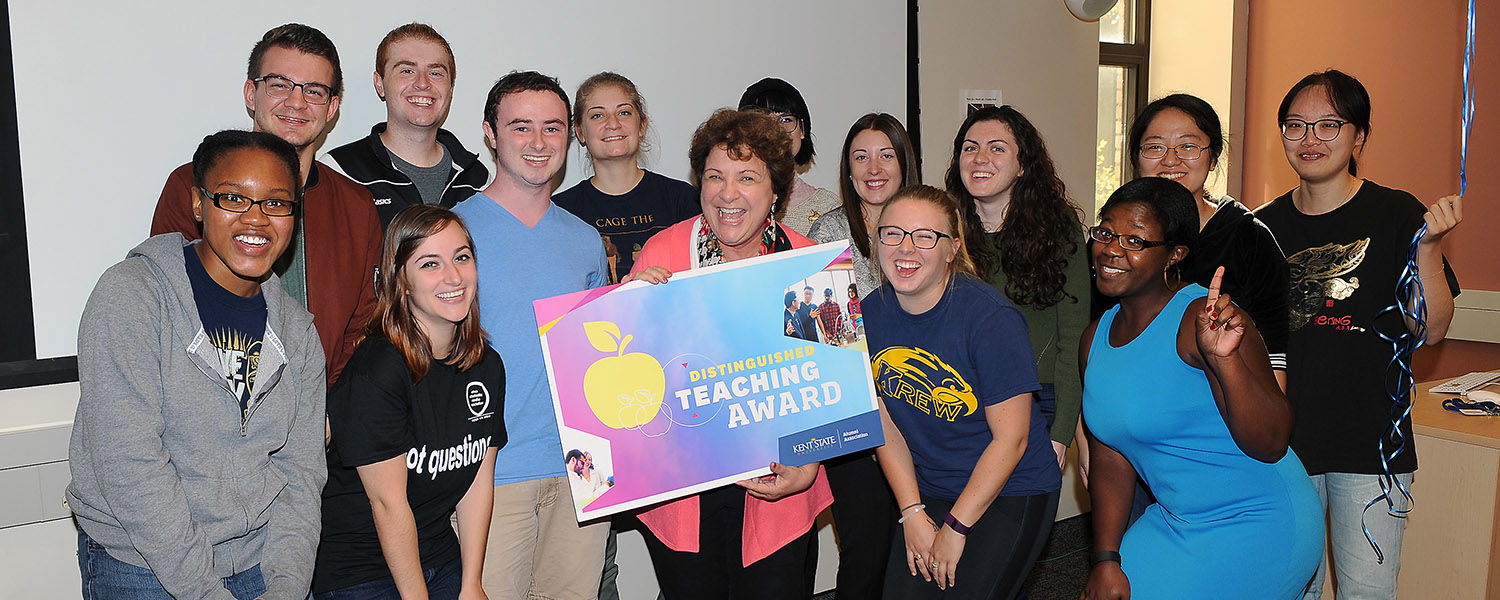 Associate Professor Jan Leach and her class pose for a picture after Leach was notified she is a 2016 Distinguished Teaching Award recipient.