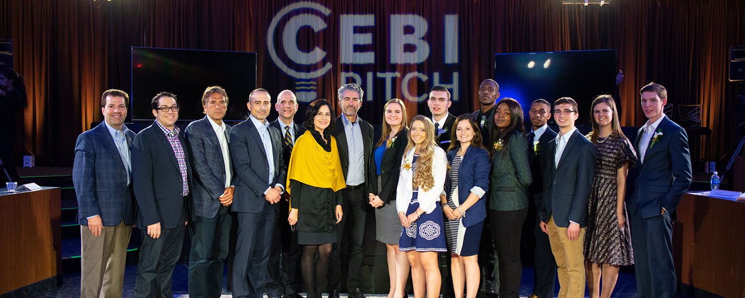 Kent State University student entrepreneurs pose with judges of the CEBIpitch competition.