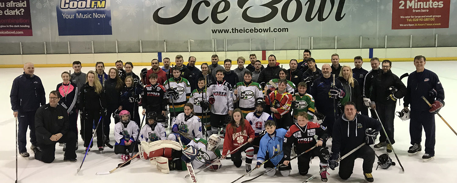 Bill Switaj, manager of Kent State University's Ice Arena, joins other coaches and participants on the ice rink during a recent USA Hockey-sponsored hockey clinic in Ireland.