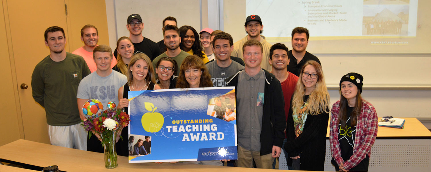 Ellen Daniels, lecturer in marketing and entrepreneurship at Kent State University, is surrounded by her students after learning that she earned a 2017 Outstanding Teaching Award.