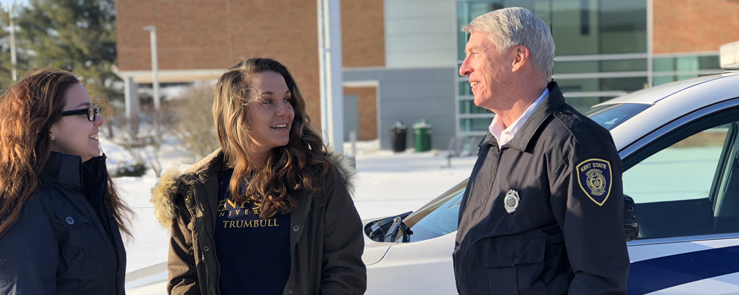 Students Sabrina Barnhart (left) and Brooklyn Bennett (center) get security tips from Gary Bateman, security and safety manager at Kent State University at Trumbull.