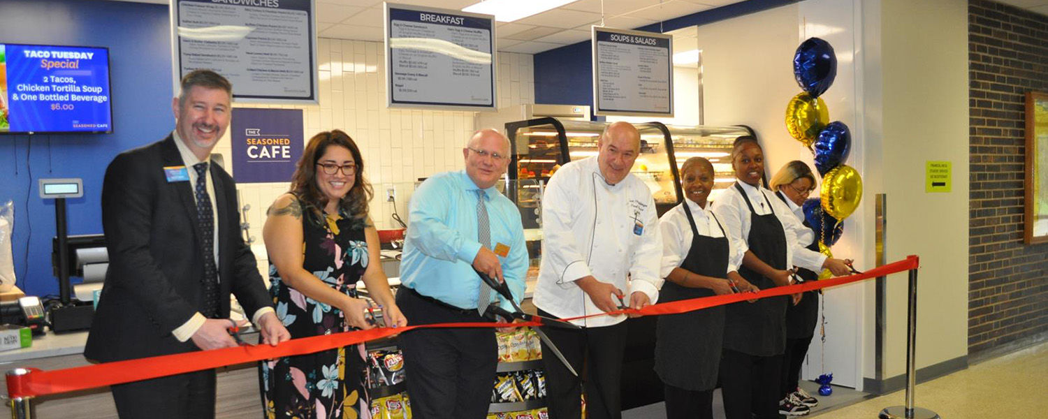 Members of the Kent State University at Salem community gathered to celebrate the opening of the new Seasoned Café on the campus. Kent State Salem Dean David Dees (third from left) led the ribbon-cutting ceremony.