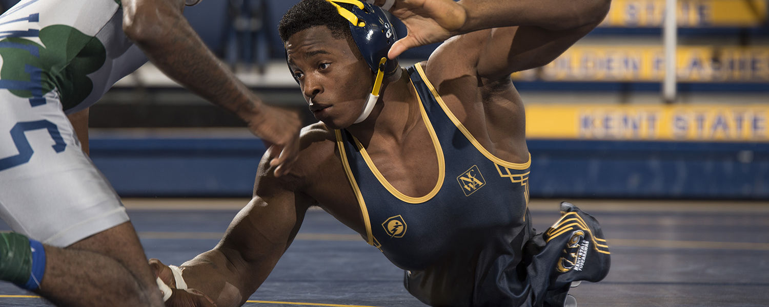 Born without legs, Kent State University at Tuscarawas student Zion Clark competes as a member of the Kent State Tuscarawas Golden Eagles wrestling team.