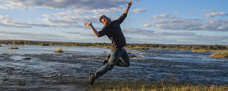 Kent State University photojournalism student Aaron Self jumps in a self-portrait taken in Zambezi National Park in Zimbabwe during his 2016 summer internship. (Photo credit: Aaron Self)