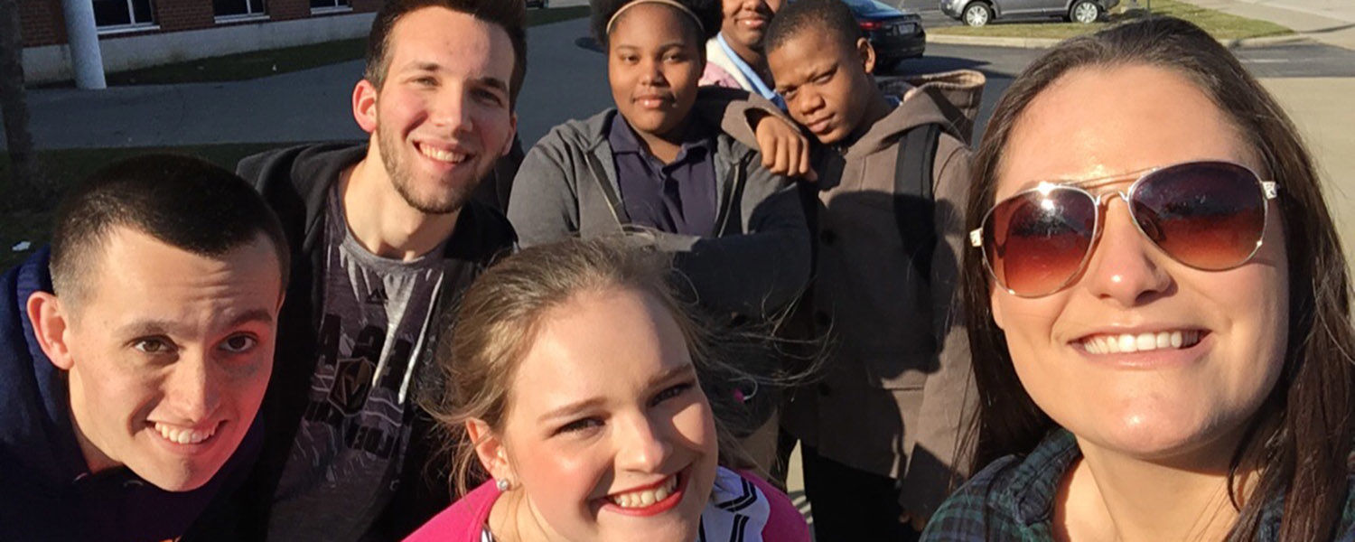 Kent State University students take a selfie with middle school students from Daniel E. Morgan School. The Kent State students worked all semester learning about and sharing the stories of the middle school students for their TV news production class.