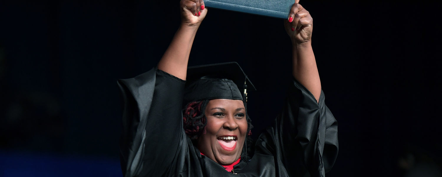 A Kent State University graduate celebrates during the 2017 Summer Commencement ceremony.