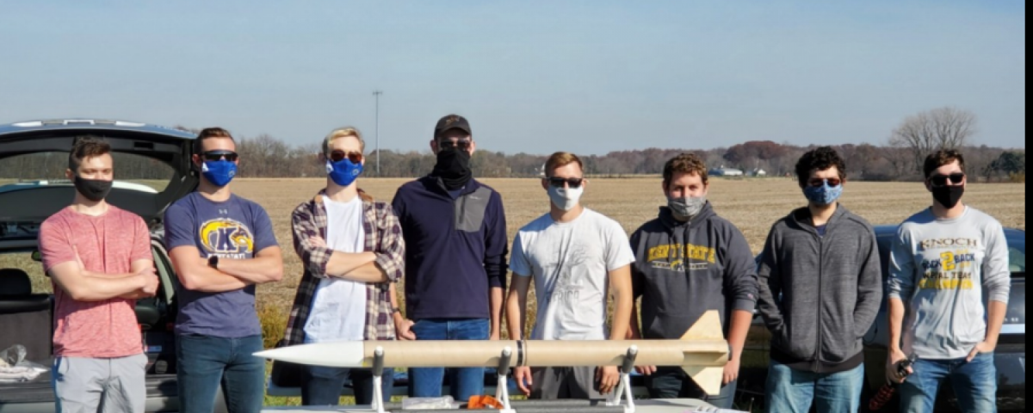 Jacob Grant (pictured third from left) pictured with the rocket built by the Kent State high powered rocket team.