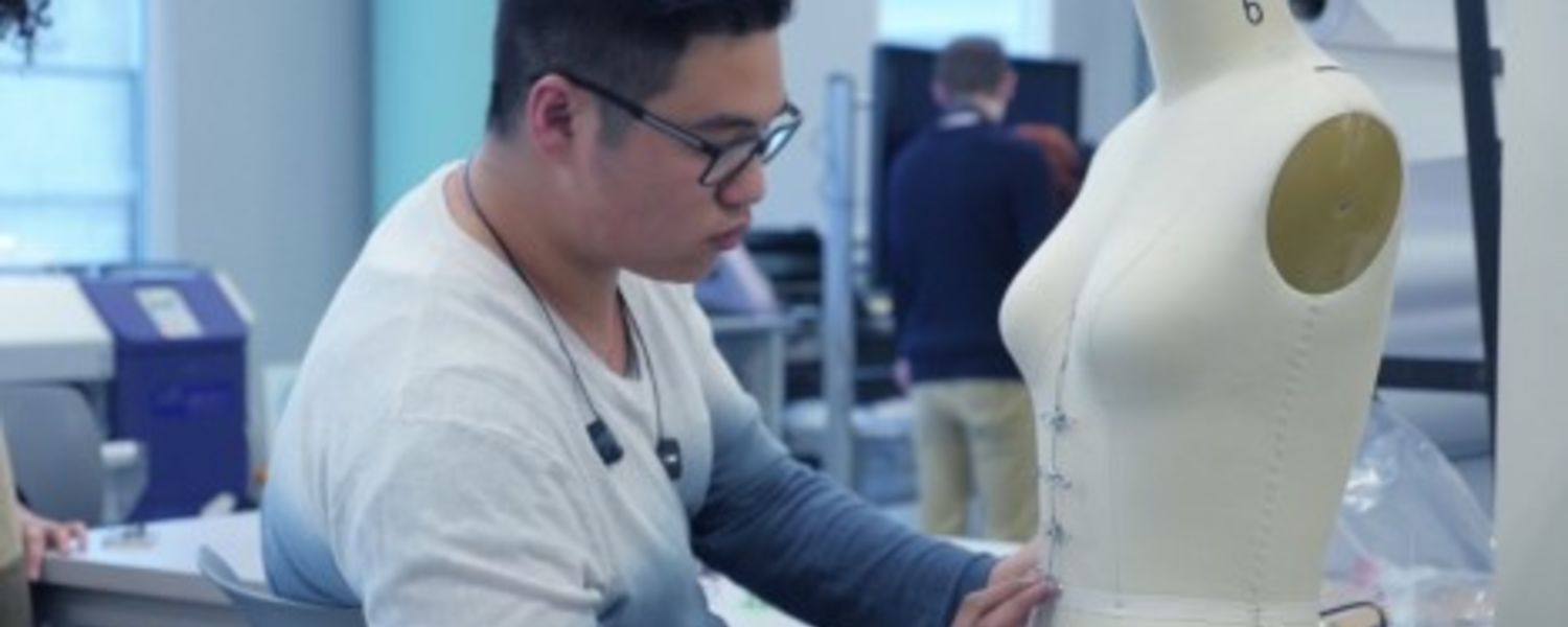 A student works on a project during the Fashion/Tech Hackathon at Kent State University.