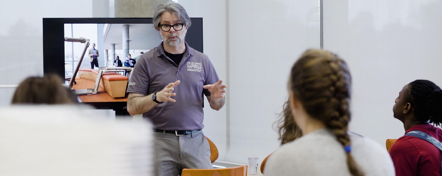 Bill Willoughby, associate dean in Kent State's College of Architecture and Environmental Design, addresses students from Akron's Firestone Community Learning Center who spent a week at the university exploring academic programs, college and career paths.