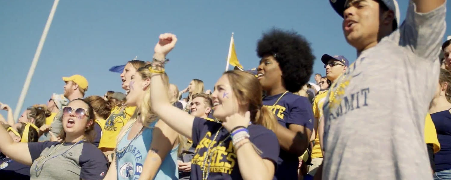 Kent State students celebrate the Golden Flashes during the Homecoming football game.
