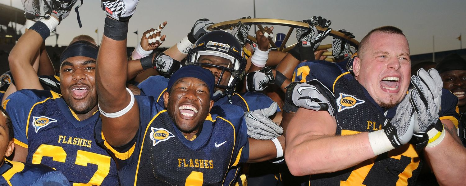 The Kent State Football team celebrates a victory against Akron.