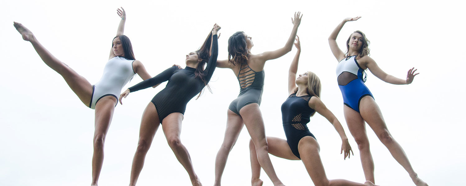 Dancers striking a pose over a white background.