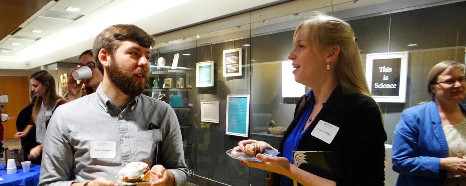 Two students talk at the SLIS New Student Reception 2015