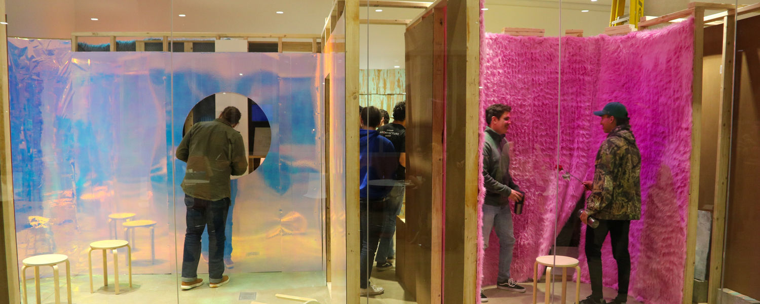 Students interacting with the gallery exhibition