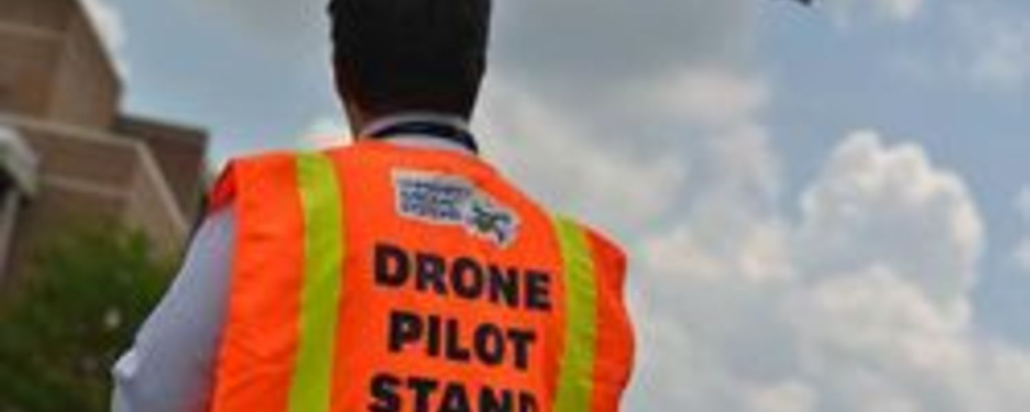 Drone pilot flying a drone