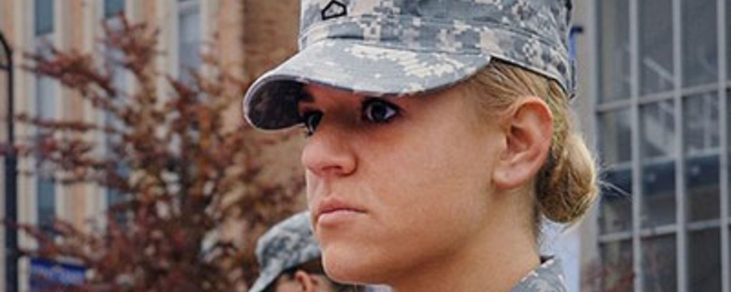A female ROTC Army member participating in a flag folding ceremony.