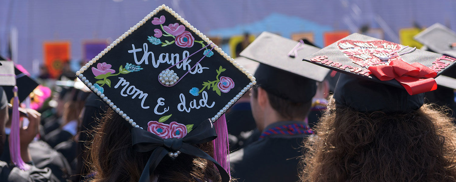 A student's decorated graduation cap.