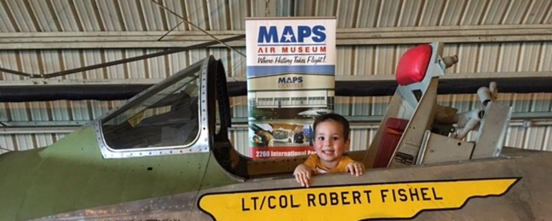 photo 2016 Aero Fair attendee enjoys MAPS aircraft exhibit