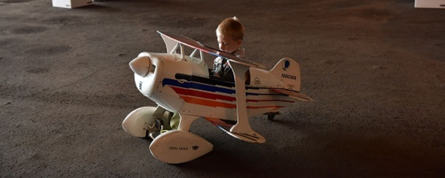 photo 2016 Aero Fair child enjoying a pedal car airplane