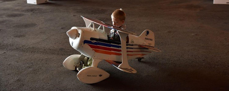 photo 2016 Aero Fair child enjoying a pedal car airplane