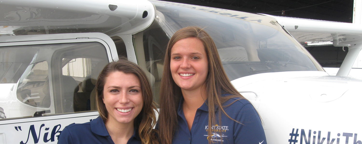 Carissa Marion (left) Jalia Manga (right) are the first female pilot team from Kent State to compete in the Air Race Classic. Follow their progress on Twitter using #NikkiTheTopHawk.