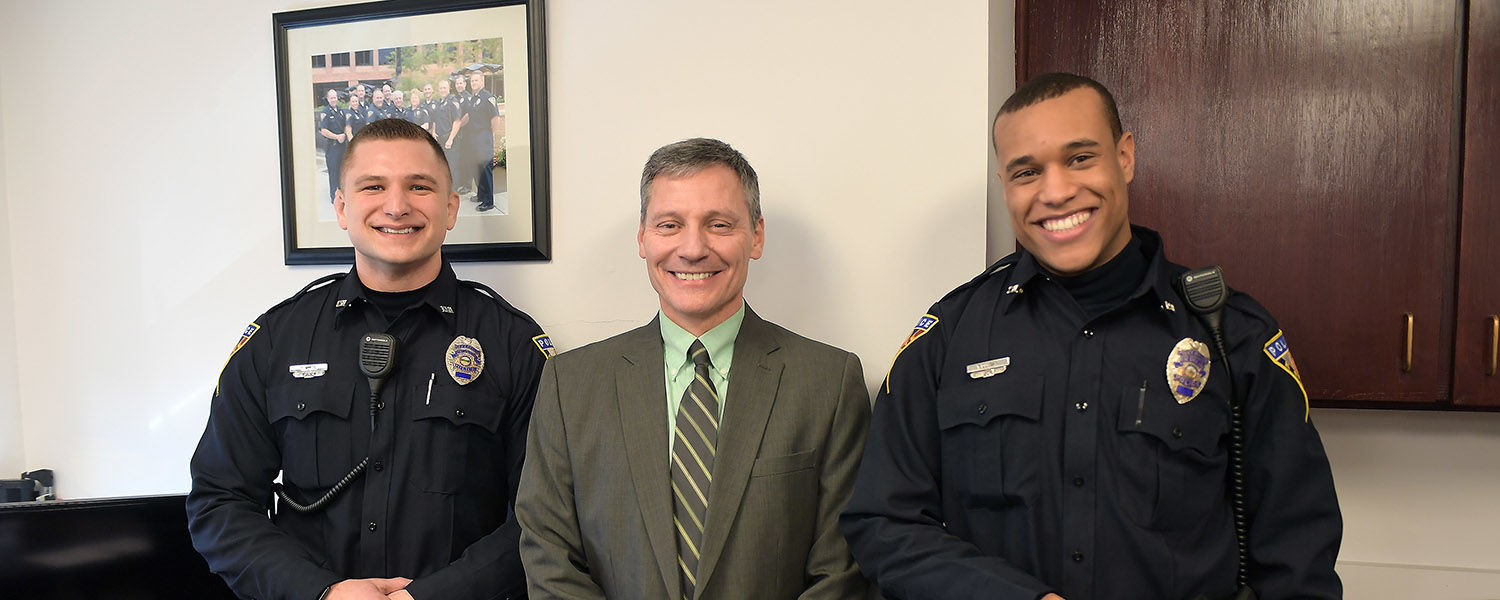 Trevor White (left) and Terrance Duncan (right) were sworn in as Kent State University Police Services' newest officers in a ceremony presided over by Chief of Police Dean Tondiglia (center).