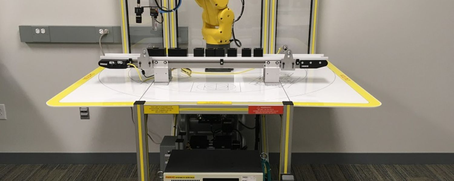 photo Applied Engineering FANUC robot with conveyor on fenceless cart