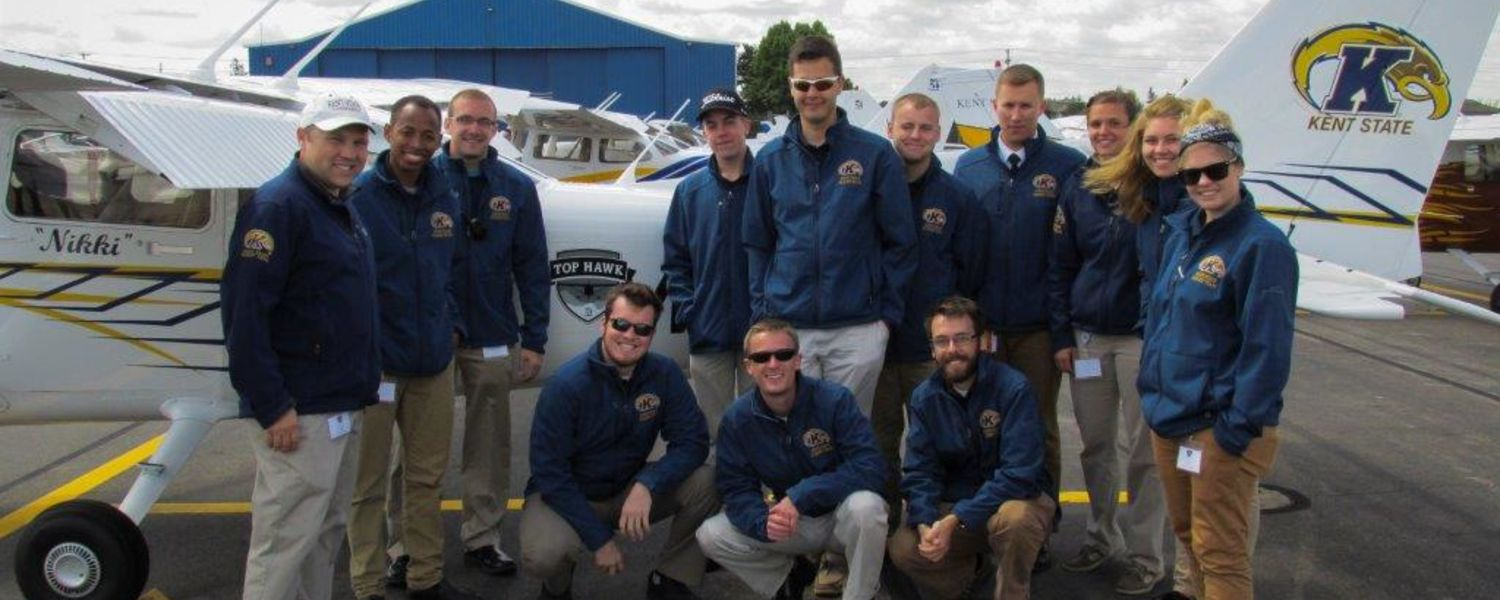 photo Kent State Precision Flight Team in front of Top Hawk Nikki